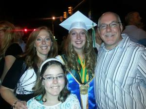 My Mom, sister, uncle ,and me at my high school graduation.
